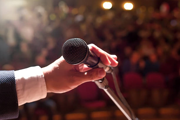 Microphone with crowd stock photo