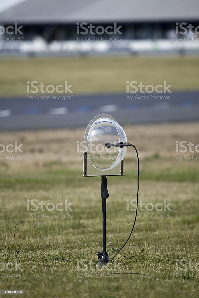 Microphone with parabola recording audio at a racetrack. stock photo