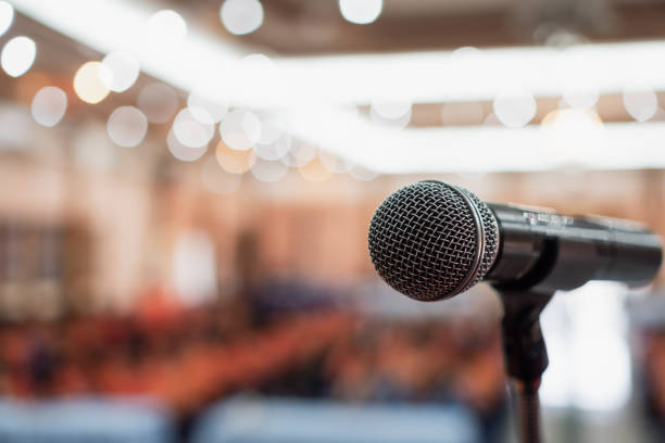 Microphones for speech or speaking in seminar Conference room, talking for lecture to audience university, Event light convention hall Background. Business Talk Presentation concept Microphones for speech or speaking in seminar Conference room, talking for lecture to audience university, Event light convention hall Background. Business Talk Presentation concept speech stock pictures, royalty-free photos & images