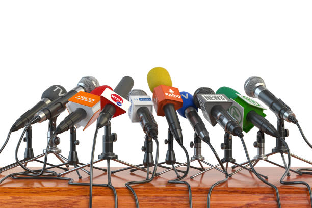 Microphones of different mass media, radio, tv and press prepared for conference meeting. Press conference or interview concept. stock photo