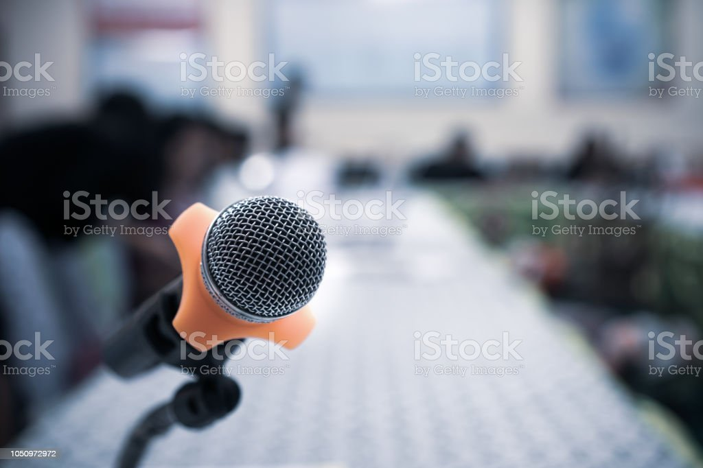 Microphones on abstract blurred of speech in seminar room or front...