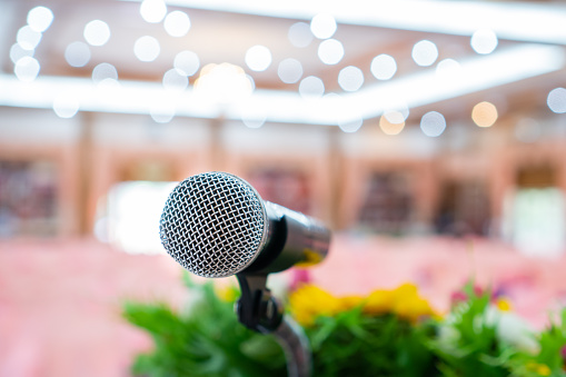 Microphones On Abstract Blurred Of Speech In Seminar Room Speaking Conference Hall Light For Presentation In Exhibition Event Background Mic Is Transducer That Convert Sound Into Electrical Signal Stock Photo - Download Image Now