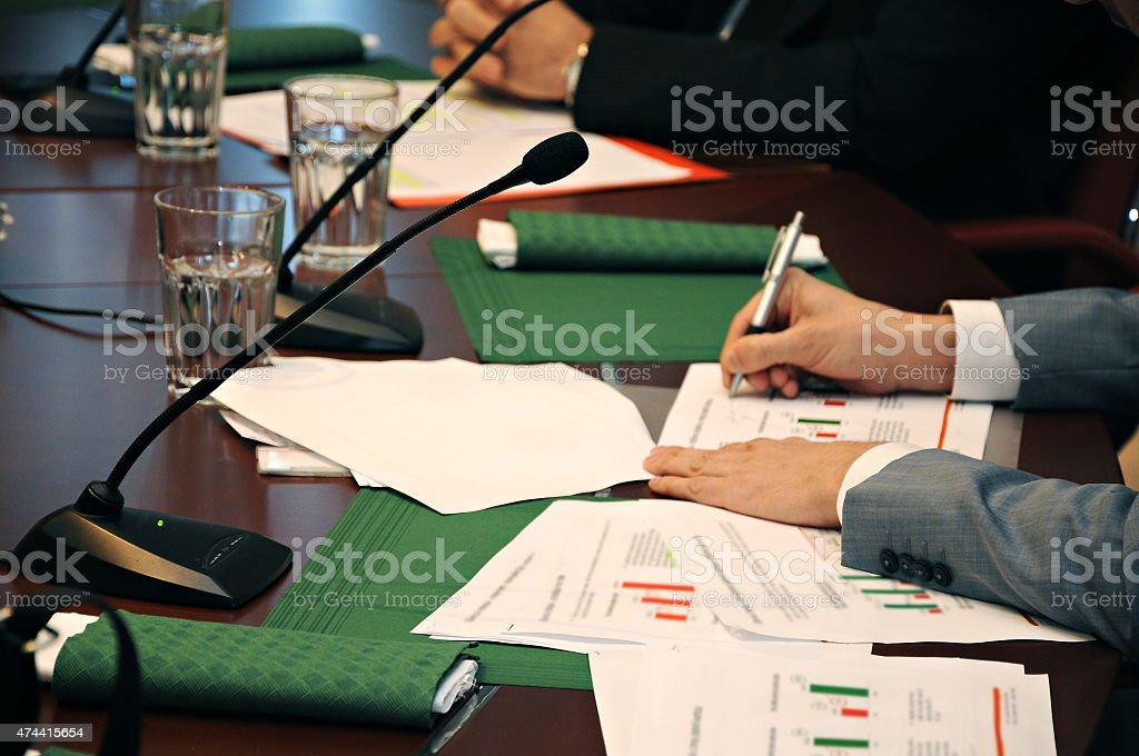 Microphones on conference room desk stock photo