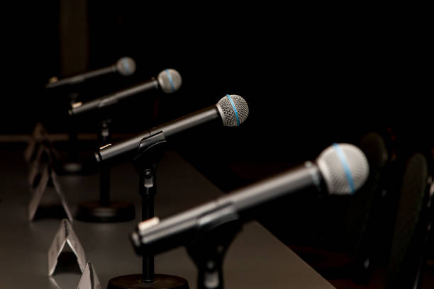 Microphones Microphones in press conference room, prepared for press conference. debate stock pictures, royalty-free photos & images