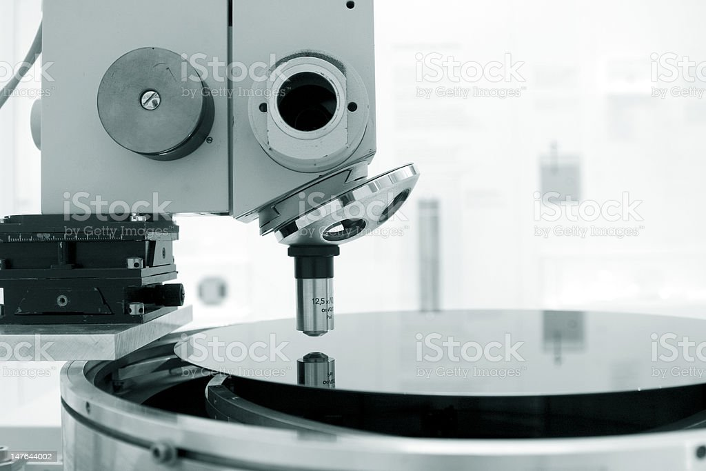 Microscope and  silikon wafer stock photo