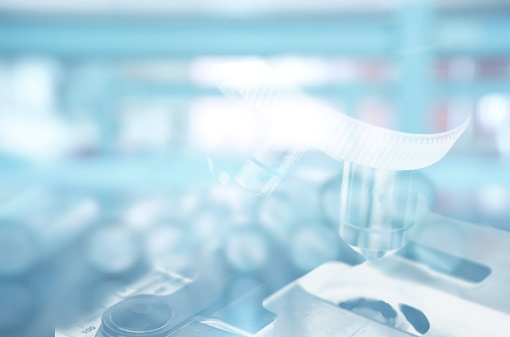 istock microscope and test tube in laboratory background 680547852