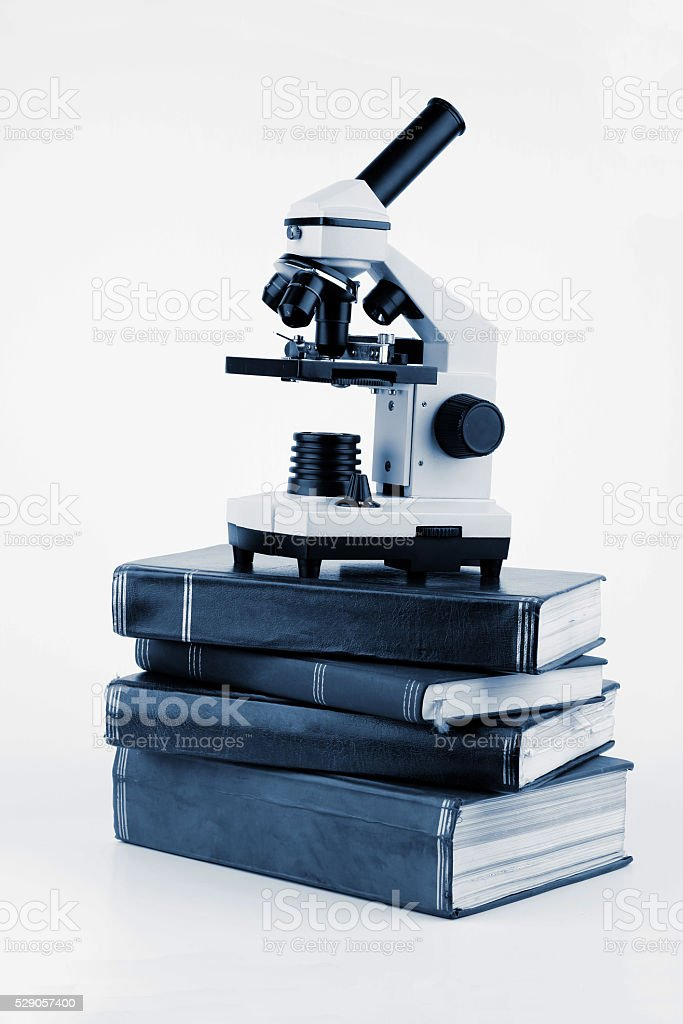 Microscope on the books stock photo