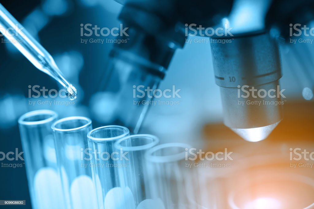 microscope with lab glassware stock photo
