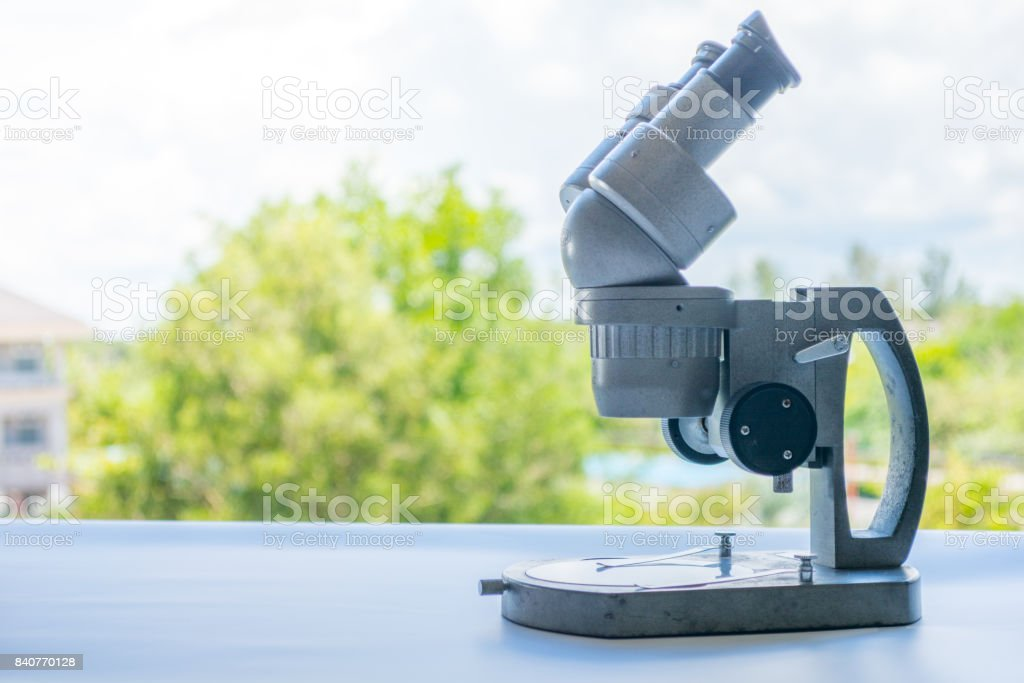 Microscopes and scientific experiments on the table. stock photo