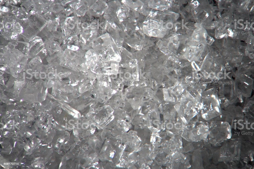 Microscopic sugar transparent crystals. Food background texture. Super macro close-up by microscope stock photo