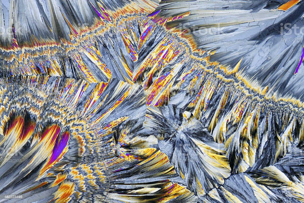 Microscopic view of sucrose crystals in polarized light stock photo