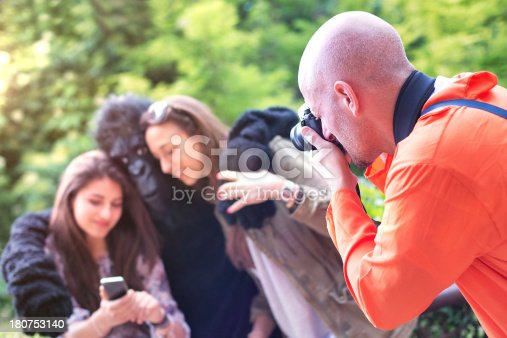 Microstocker in Action. A Photographer is Taking a picture at Two Girls and a Gorilla who are texting with a mobile phone. The photo is taken during an unofficial minilypse in Italy.