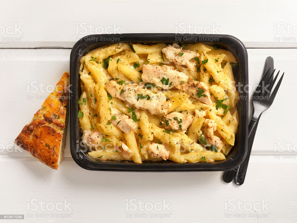 Microwave Dinner -Chicken and Penne Alfredo stock photo