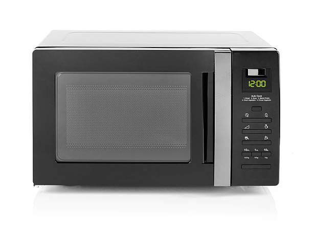Microwave oven isolated on white stock photo