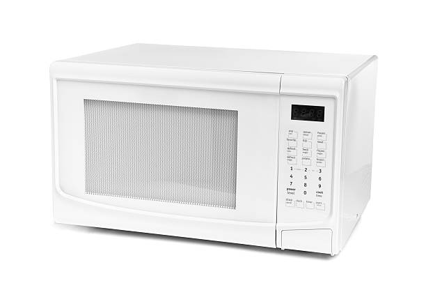 Microwave Oven New microwave oven on white background. touchpad stock pictures, royalty-free photos & images