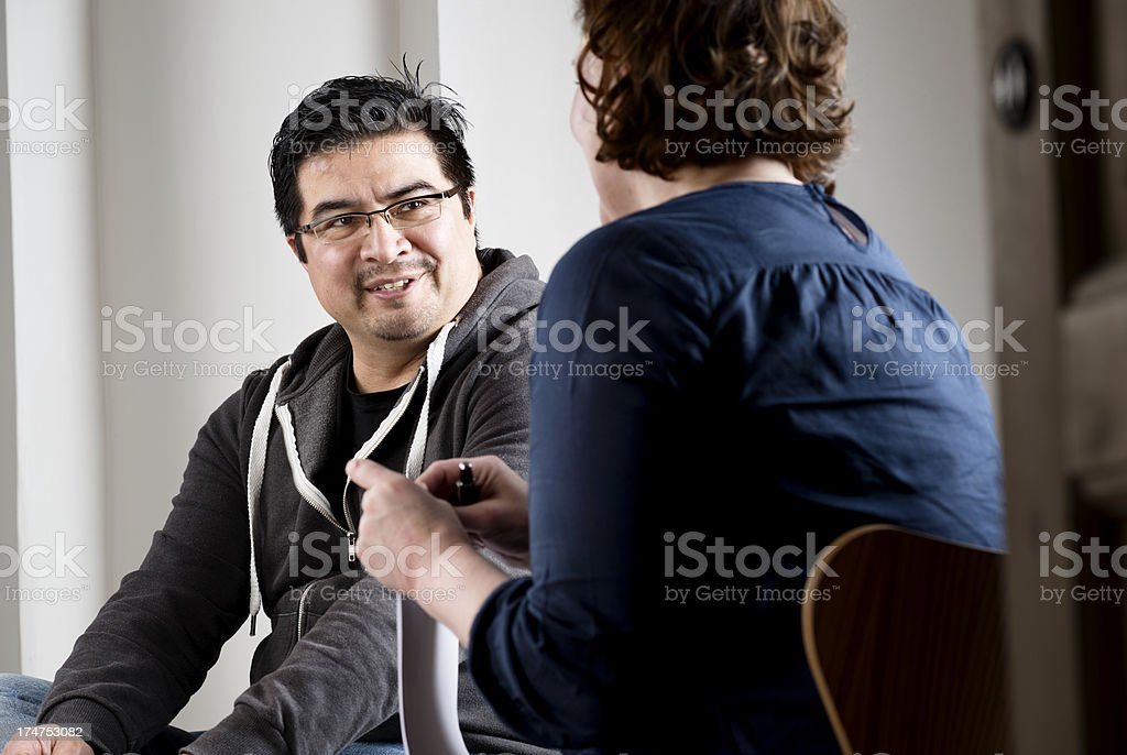 Mid 40's Male Taking Part In a Counselling Session stock photo