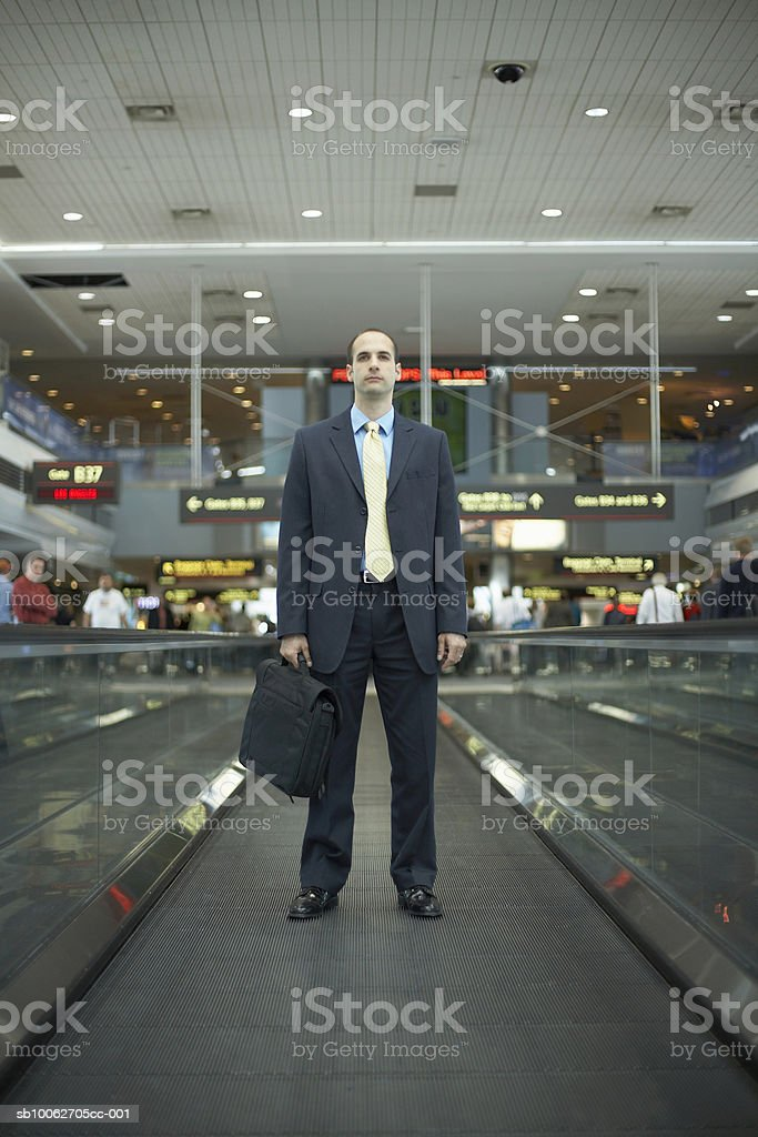 Mid adult business man carrying briefcase at airport 免版稅 stock photo