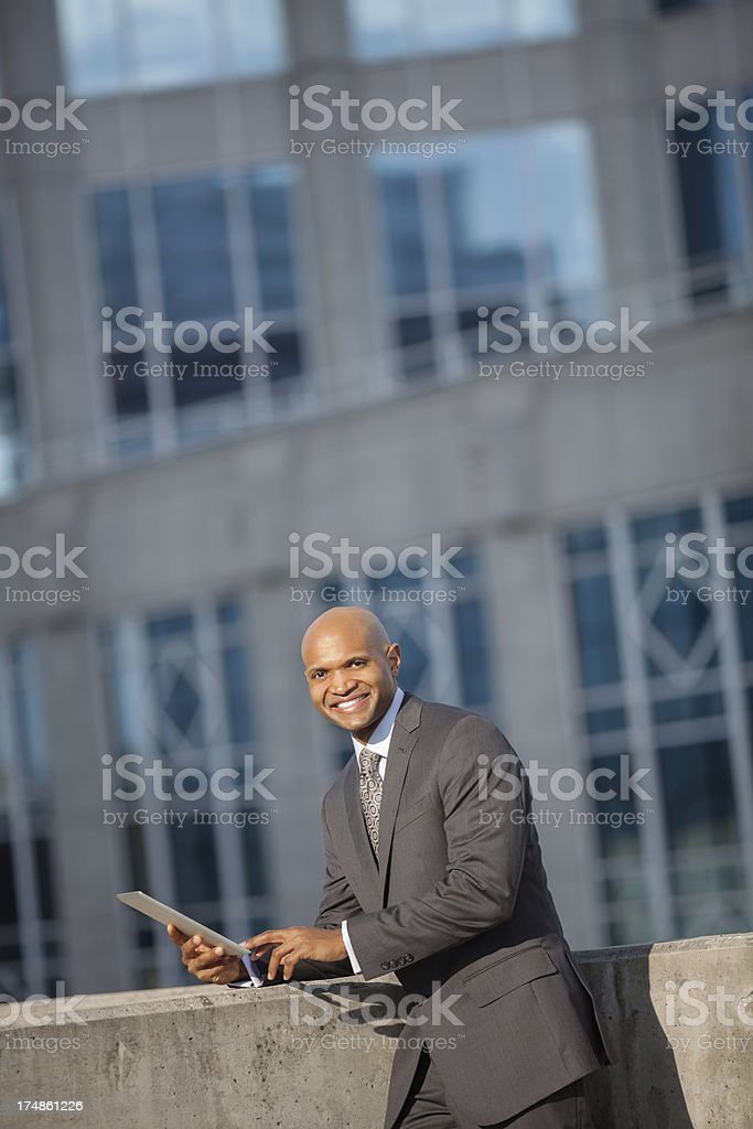 Mid Adult Businessman Using Digital Tablet royalty-free stock photo