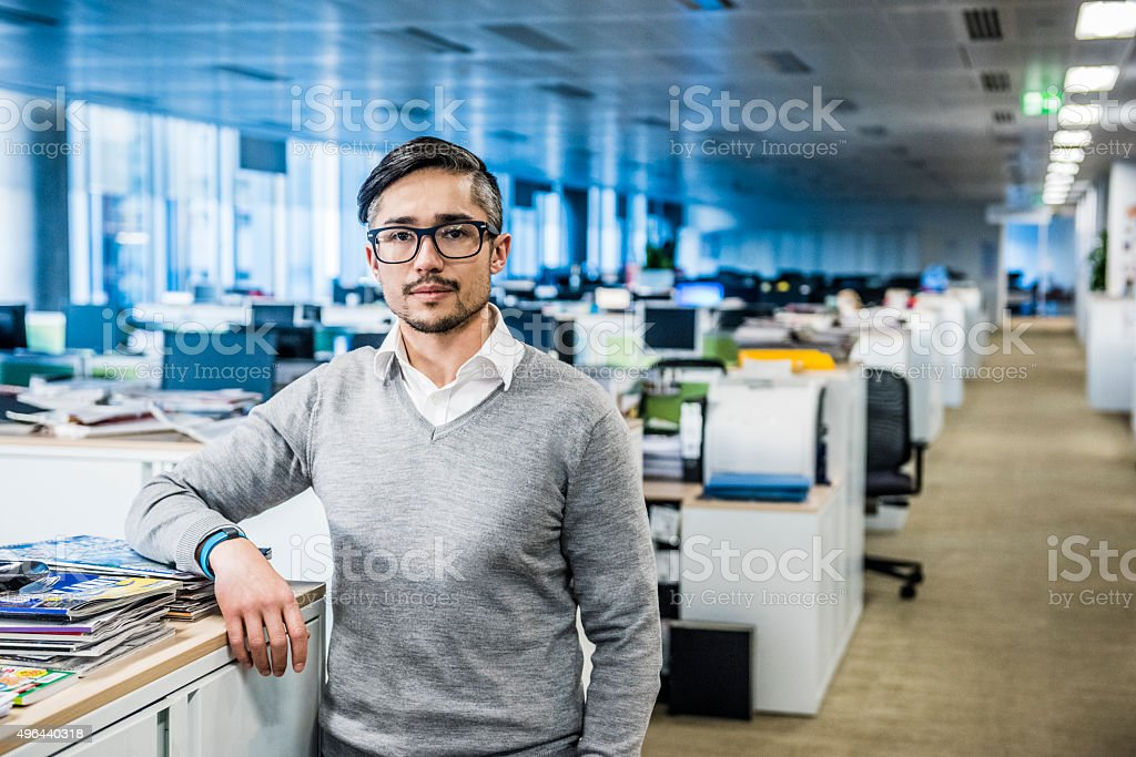 Mid adult businessman wearing glasses in office, portrait stock photo