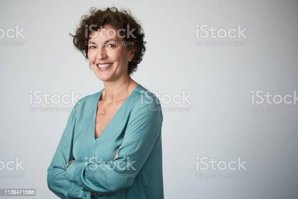 Mid adult businesswoman headshot on grey background picture id1126471588?b=1&k=6&m=1126471588&s=612x612&h=h j2mgljeqsvqggwor1j5 qvz611igxcpg z1ss2zvy=