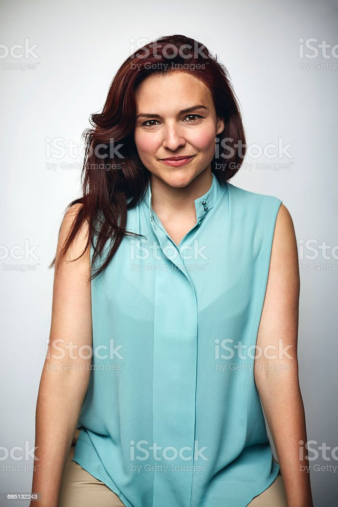 Mid adult businesswoman smiling over white stock photo