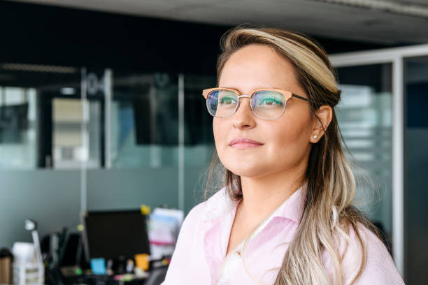 Mid adult businesswoman wearing glasses stock photo