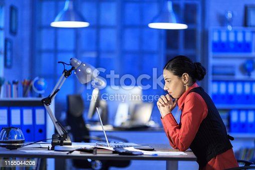 Mid adult businesswoman working late and having problem