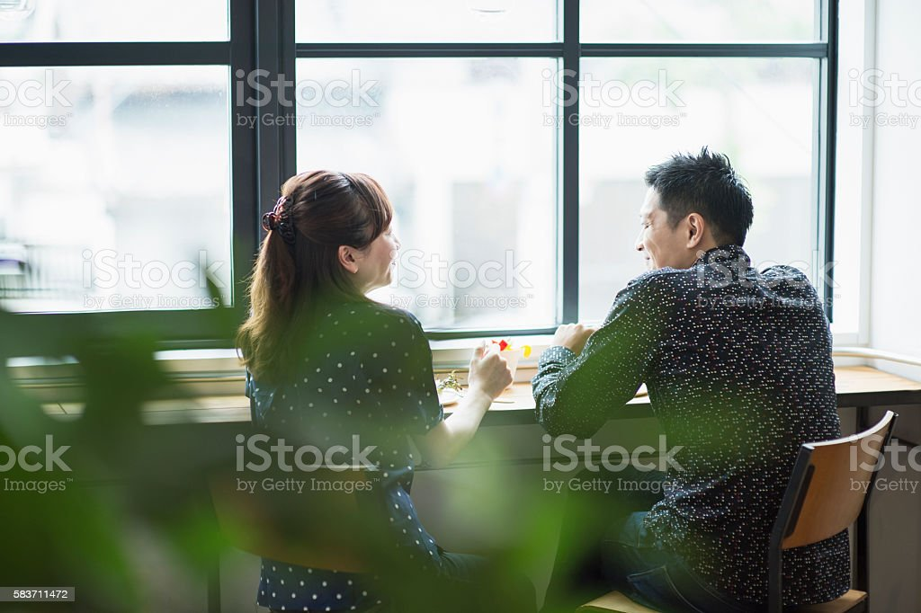 Mid adult couple enjoying Lunch in cafe. stock photo