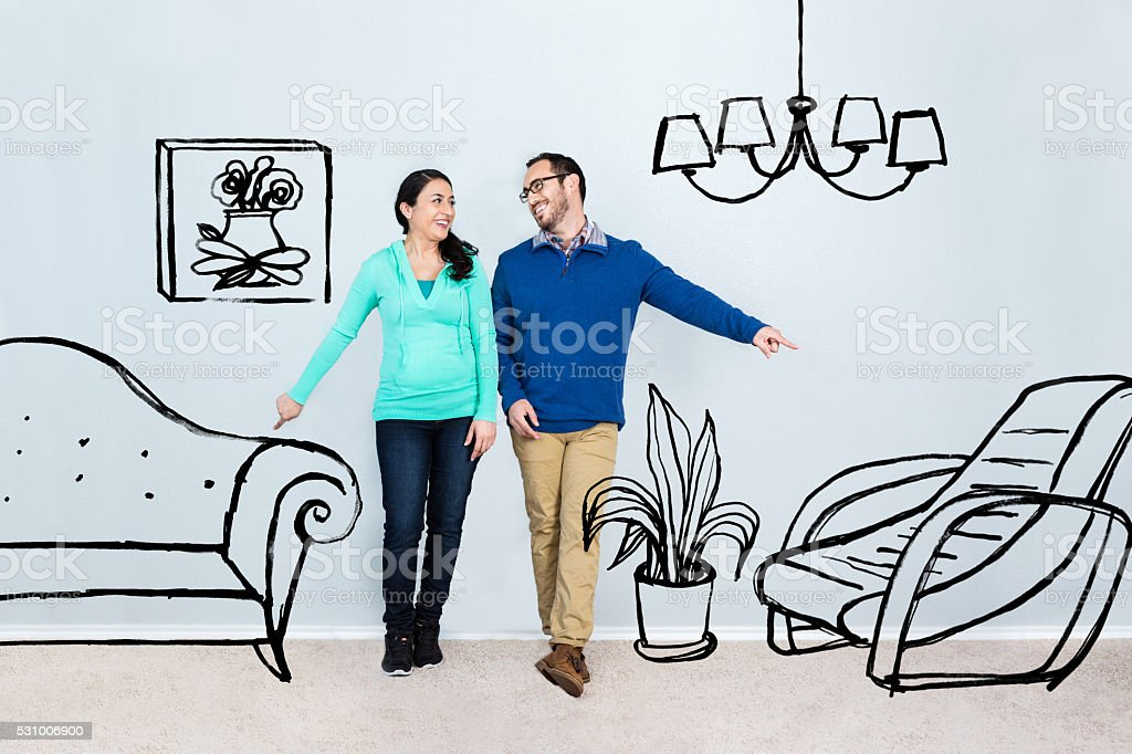 Mid adult couple imagine life in their new home stock photo
