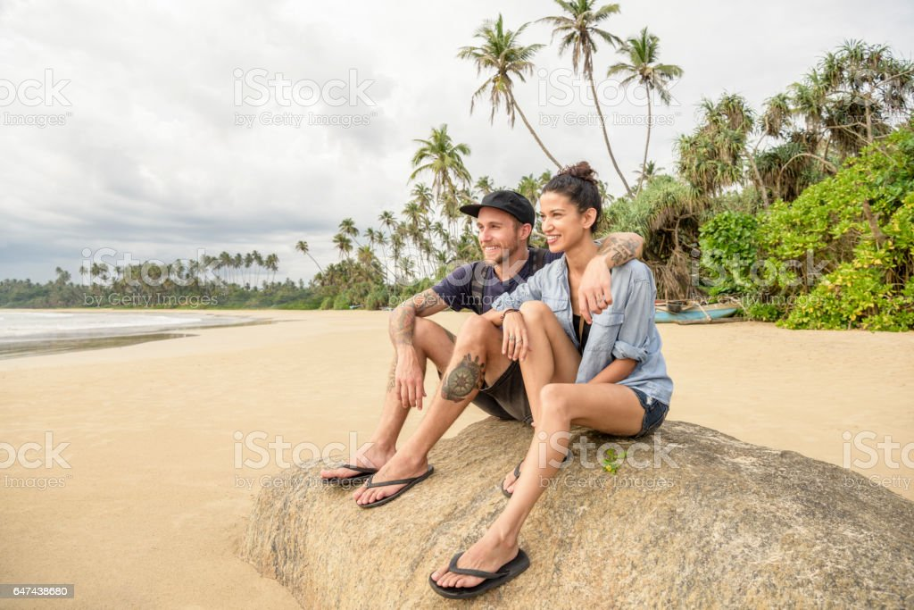 Mid adult couple on beach in Sri Lanka looking at view stock photo