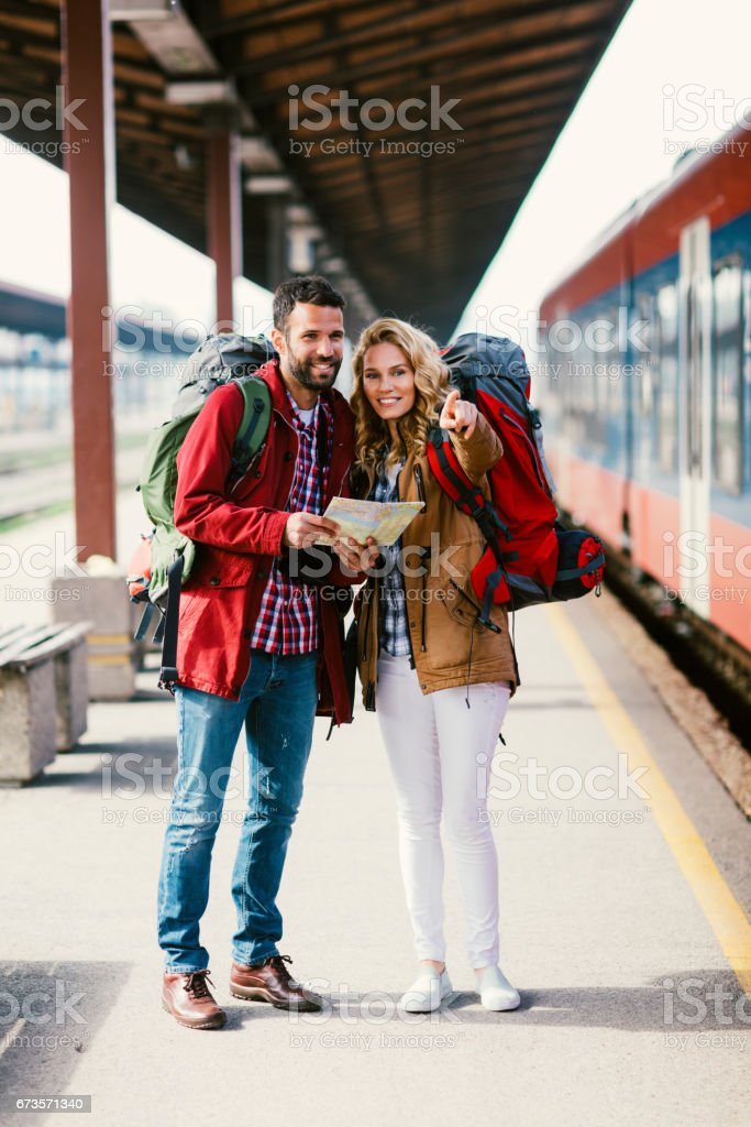 Mid adult couple on railroad station royalty-free stock photo