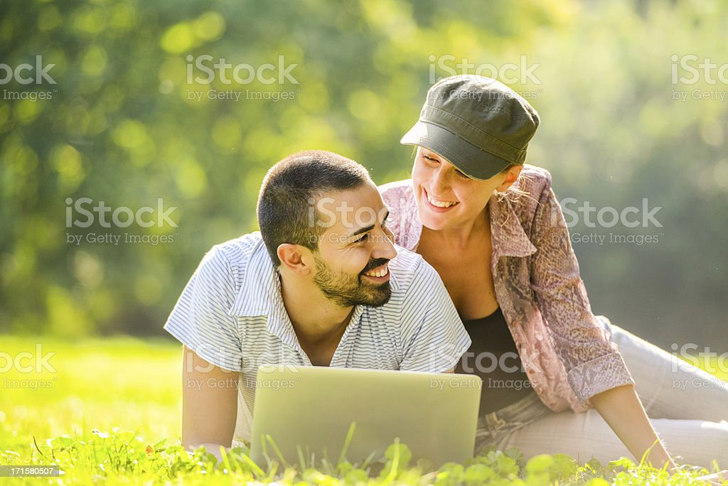 Mid Adult couple using laptop  outdoors royalty-free stock photo