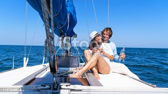 Couple drinking champaigne on a yacht in the sea
