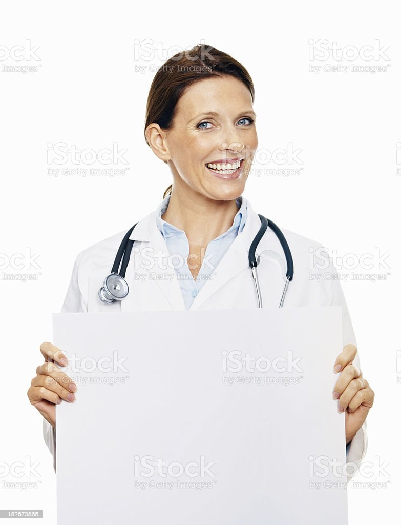 Mid adult doctor holding an advertisement board royalty-free stock photo