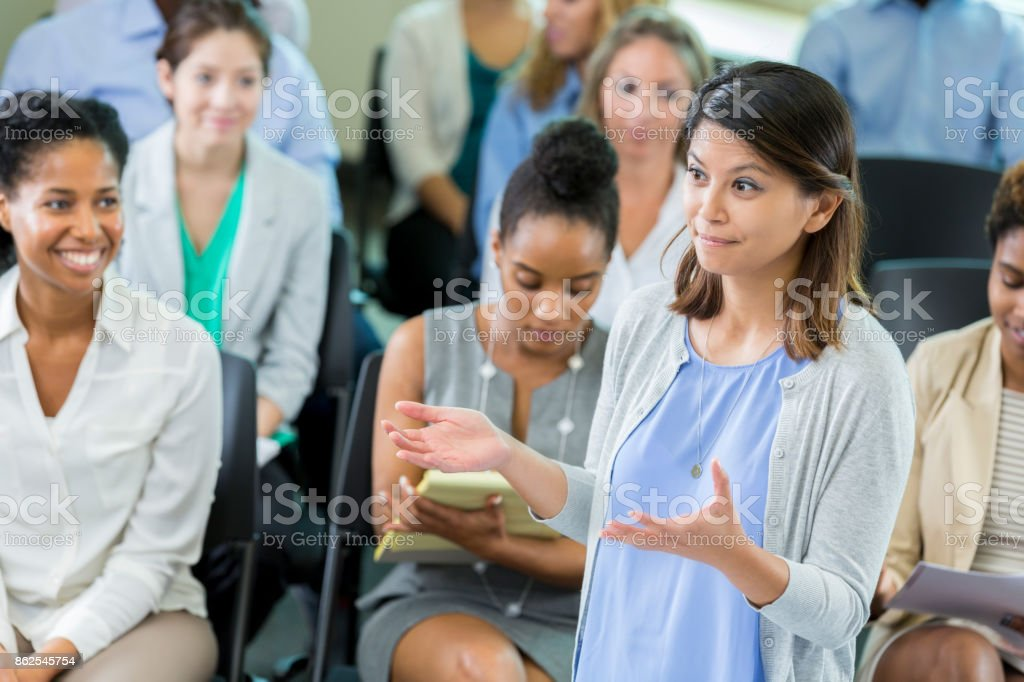 Mid adult female business professor talk with her hands stock photo
