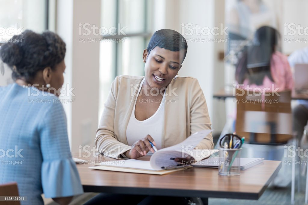 Mid Adult Loan Officer With Customer Stock Photo ...