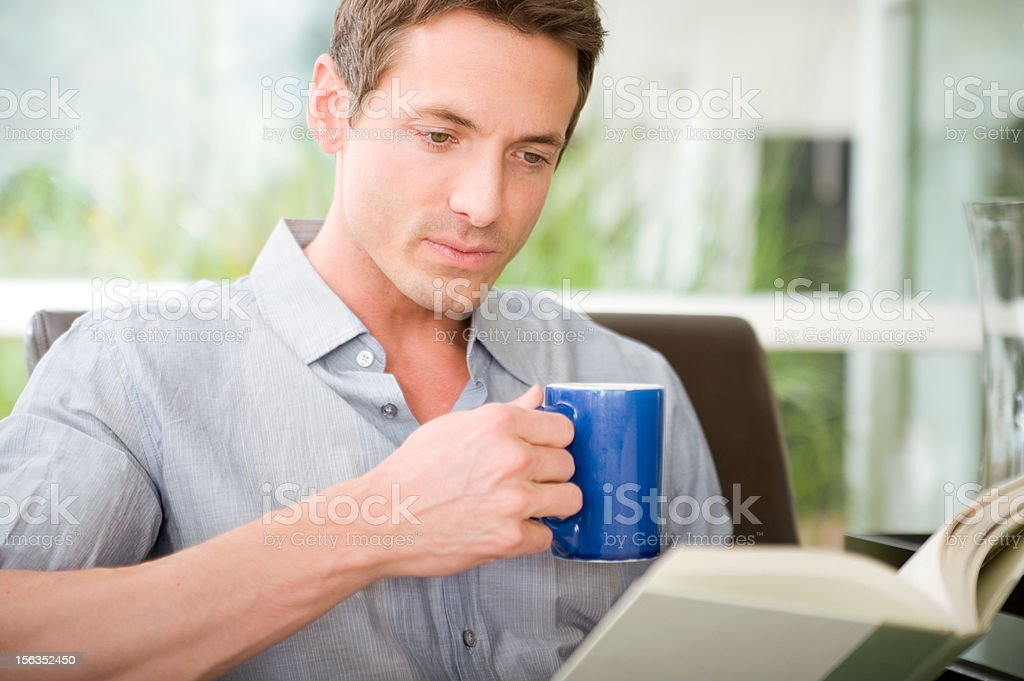 Mid adult male reading royalty-free stock photo