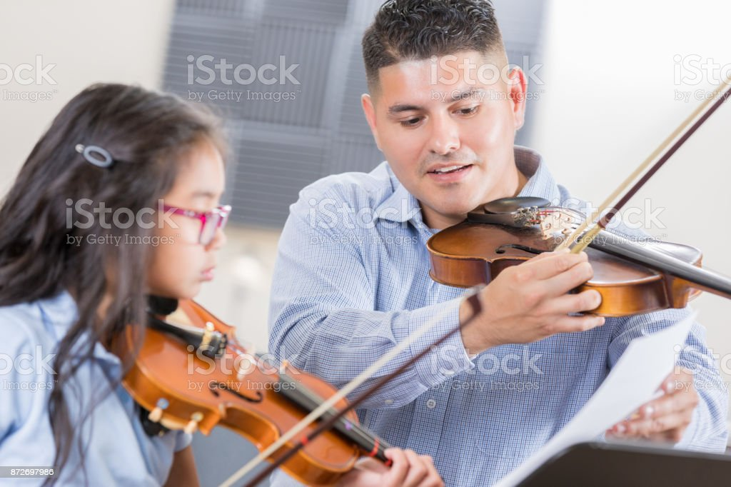 Mid Adult Male Violin Teacher Demonstrates Bow Technique