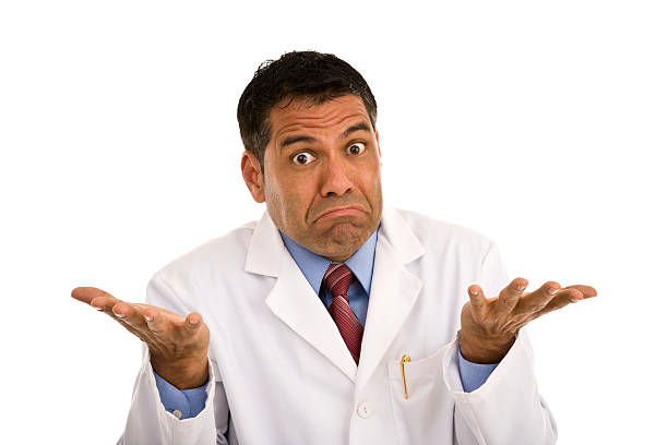 Mid adult male wearing lab coat gesturing making a face  shrugging stock pictures, royalty-free photos & images