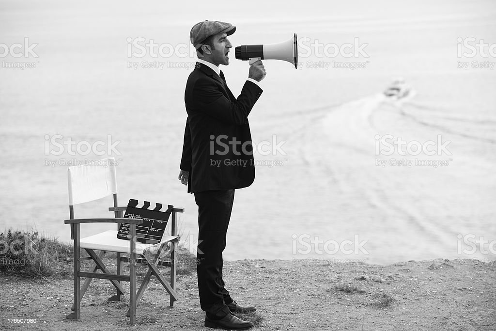 Mid Adult Man Directing Film In Outdoor Movie Set stock photo