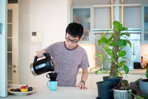 Mid adult man going through his morning routine stock photo