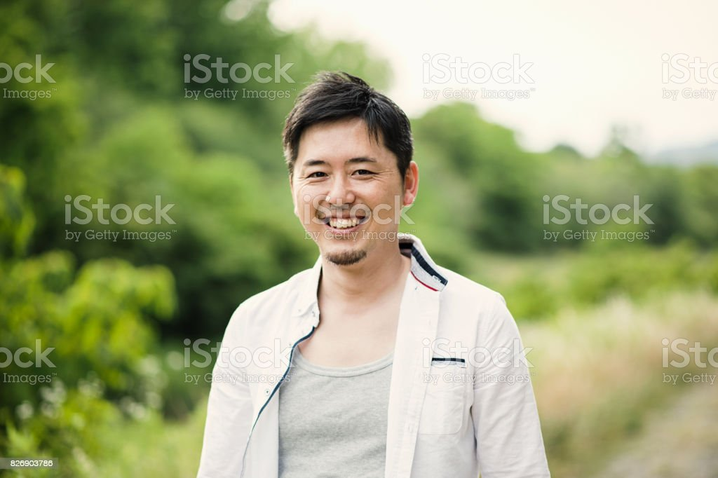 Mid adult man having a good time in outdoors stock photo