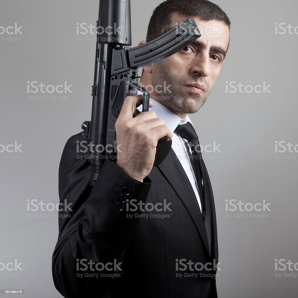 Mid Adult Man Holding Long Barreled Weapon royalty-free stock photo