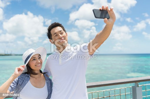 istock Mid adult man looking sea with smiling 838486864