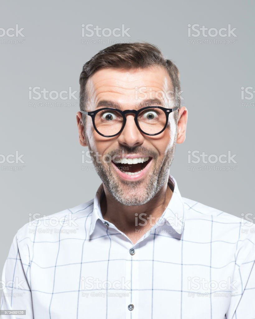Mid adult man looking surprised Close up portrait of amazed mid adult caucasian man wearing  glasses and shirt, keeping mouth wide open, looking surprised over grey background. 30-39 Years Stock Photo