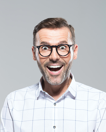 Mid Adult Man Looking Surprised Stock Photo - Download Image Now