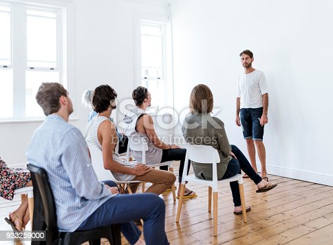 istock Mid adult man participating in group therapy 923259000