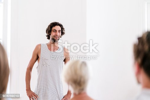 istock Mid adult man participating in group therapy 923259210