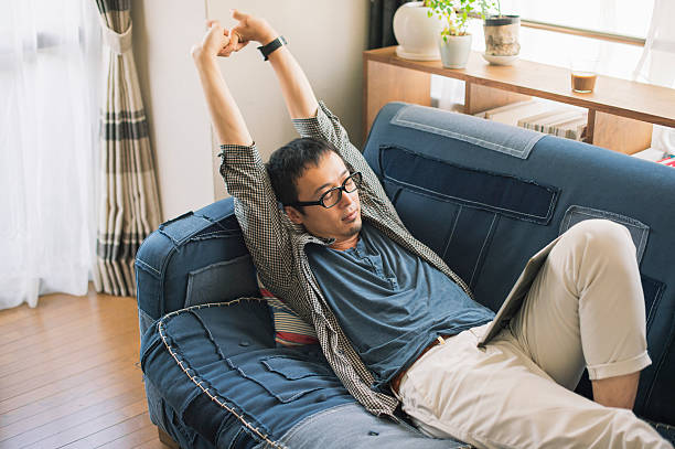 Mid adult man relaxing at home on holiday ストックフォト