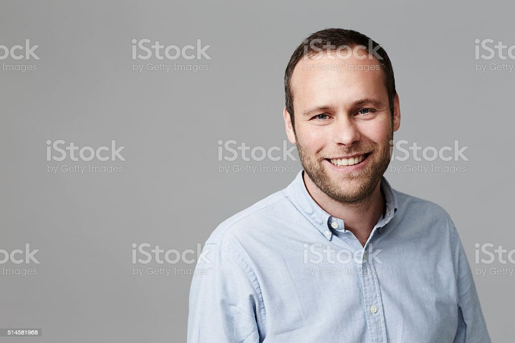 Mid adult man smiling in studio stock photo